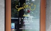 smile kohvik tartus logo kujundamine ja kleebiste valmistamine